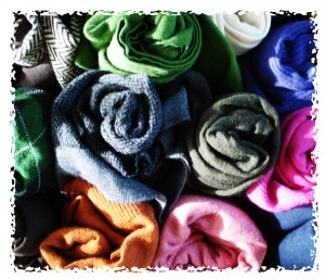 An assortment of colors of merino wool sweaters