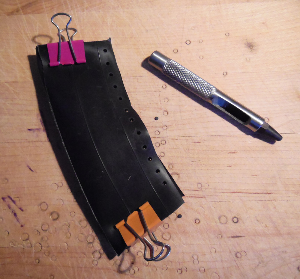 Use binder clips to hold your pieces securely, then punch through both layers at once so all your holes line up.